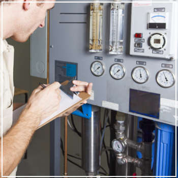 technician inspecting a water heater