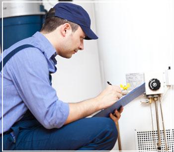 technician servicing a water heater
